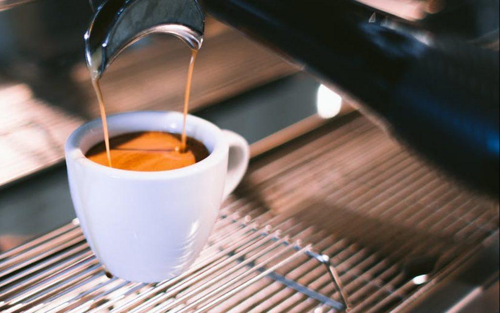 Thick crema in a shot of espresso coffee